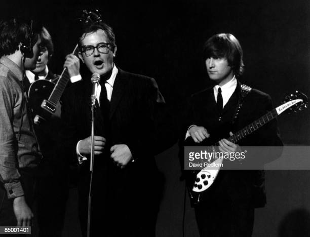 British television producer Jack Good introduces English rock and pop group The Beatles, with John Lennon behind, as they prepare to perform on stage...