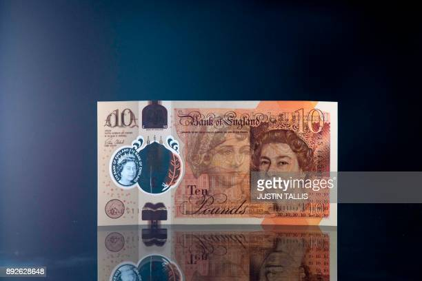 A British ten pound sterling note is arranged for a photograph in London on December 14 2017 / AFP PHOTO / Justin TALLIS