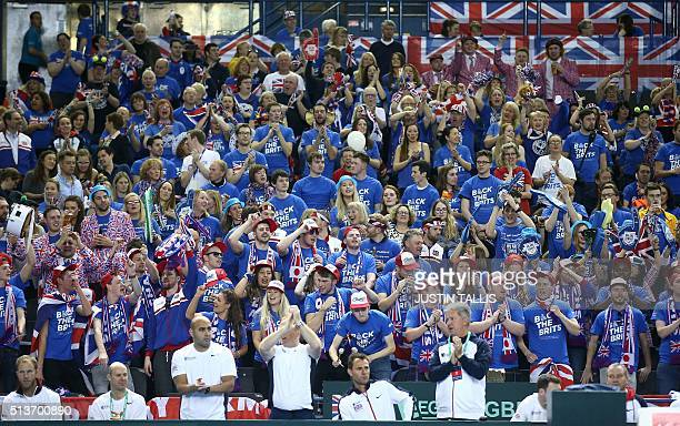 British tennis fans wait for the Davis Cup world group first round men's singles tennis match between Great Britain and Japan to start in Birmingham...