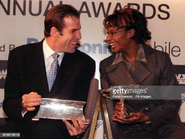 British tennis no 1 Greg Rusedski and British Heptathlon star Denise Lewis, poses with their awards after being named as the 1997 Sportsman and woman...