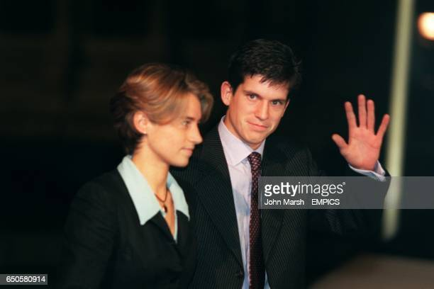 British tennis number one Tim Henman waves to the cameras as he arrives at the studios with his girlfriend Lucy Heald
