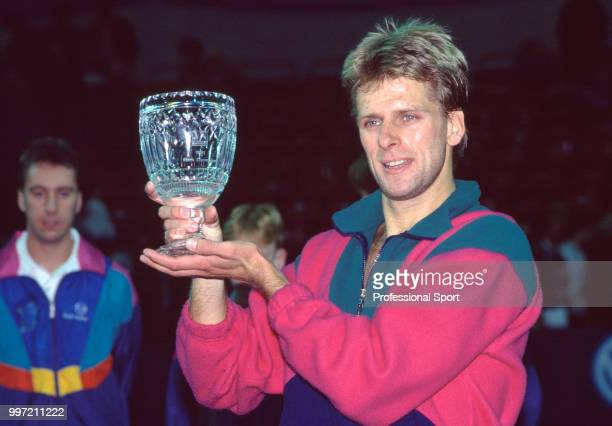 British tennis player Andrew Castle poses with the trophy after winning the Volkswagen British National Tennis Championships circa 1991