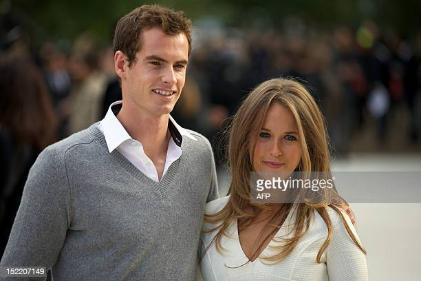 British tennis player Andy Murray and fiance Kim Sears pose as they arrive to attend the Burberry Prorsum 2013 spring/summer collection catwalk show...