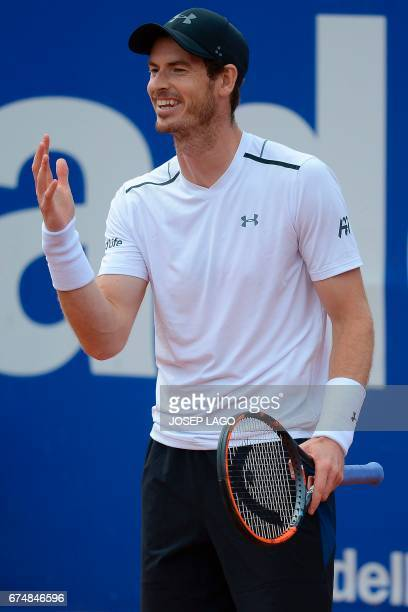 British tennis player Andy Murray gestures and smiles as he plays against Austrian tennis player Dominic Thiem during the ATP Barcelona Open 'Conde...