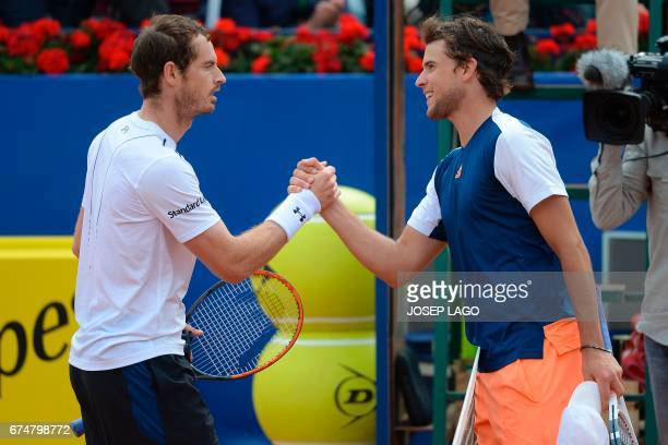 British tennis player Andy Murray greets Austrian tennis player Dominic Thiem during the ATP Barcelona Open 'Conde de Godo' tennis tournament in...