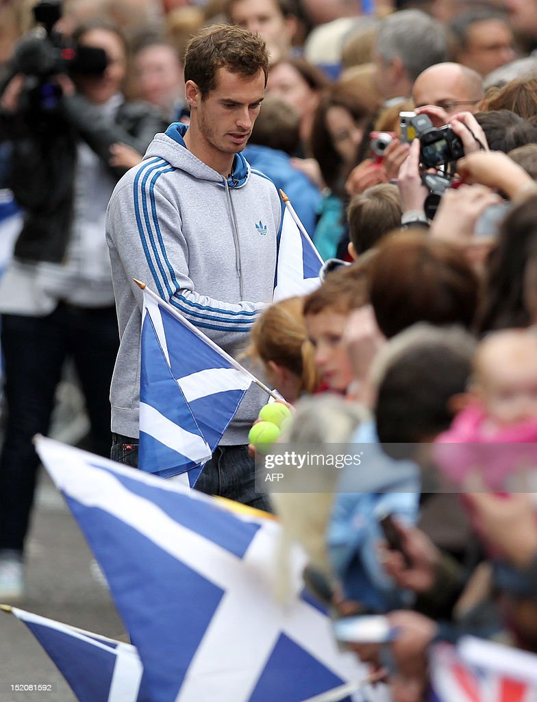 British tennis player Andy Murray meets with fans in the centre of Dunblane, Scotland on September 16, 2012, following his victory in the US Open tennis tournament and gold medal in the London 2012 Olympic Games. Andy Murray, the first British man to win a Grand Slam title in 76 years, received a rapturous welcome in his Scottish home town on Sunday, but admitted that his golden summer was giving him nightmares.