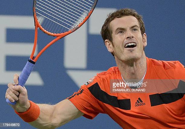 British tennis player Andy Murray plays a point against Uzbekistan's Denis Istomin during their 2013 US Open men's singles match at the USTA Billie...