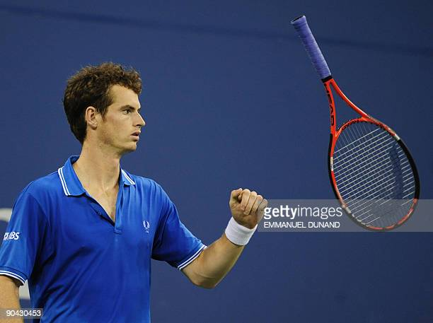British tennis player Andy Murray plays with his racket during his match against US Taylor Dent during day seven of the 2009 US Open at the USTA...