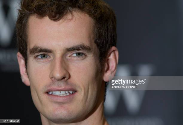 British tennis player Andy Murray poses for pictures as he launches his new book 'Andy Murray SeventySeven My Road to Wimbledon Glory' at a bookstore...