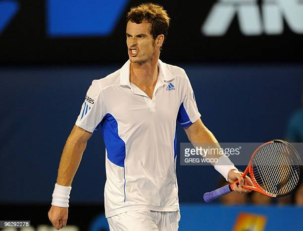 British tennis player Andy Murray reacts during his men's singles final match against Swiss opponent Roger Federer at the Australian Open tennis...