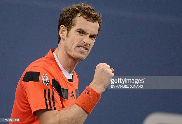 British tennis player Andy Murray reacts playing a point against Uzbekistan's Denis Istomin during their 2013 US Open men's singles match at the USTA...