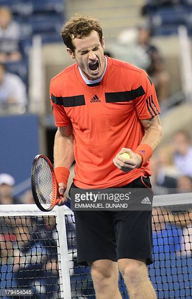 British tennis player Andy Murray reacts winning against Uzbekistan's Denis Istomin during their 2013 US Open men's singles match at the USTA Billie...