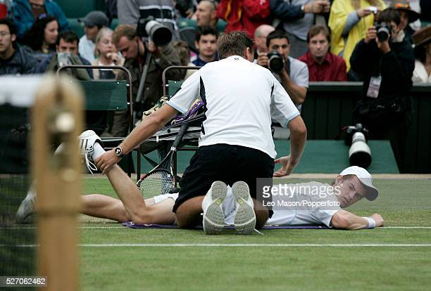 British tennis player Andy Murray receives on court assistance for cramp during the 5th set of his third round match against David Nalbandian of...