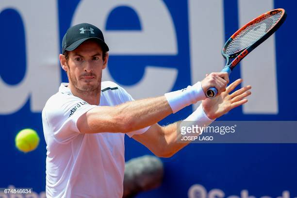 British tennis player Andy Murray returns the ball to Austrian tennis player Dominic Thiem during the ATP Barcelona Open 'Conde de Godo' tennis...