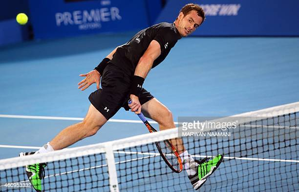 British tennis player Andy Murray returns the ball to Feliciano Lopez of Spain during their game in the Mubadala World Tennis Championship in Abu...