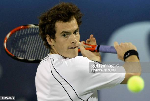 British tennis player Andy Murray returns the ball to Sergiy Stakhovsky of the Ukraine on the first day of the ATP Dubai tennis championships in the...