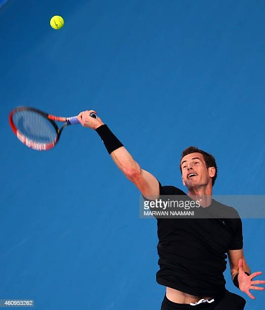 British tennis player Andy Murray serves the ball to Feliciano Lopez of Spain during their game in the Mubadala World Tennis Championship in Abu...