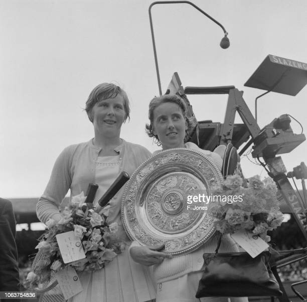British tennis player Angela Mortimer holding her Wimbledon trophy with the runnerup in the final British tennis player Christine Truman All England...