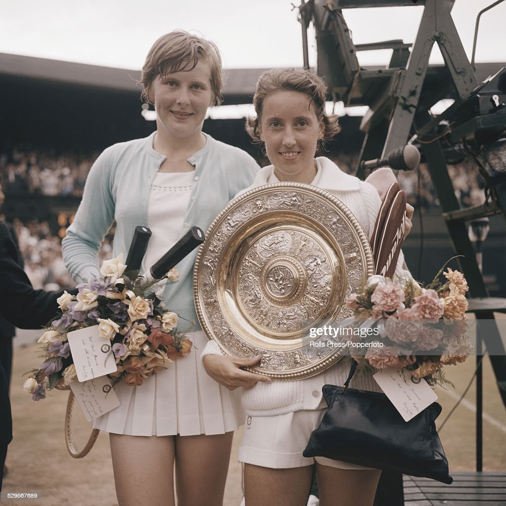 British tennis player Angela Mortimer holds her trophy after defeating fellow Briton, Christine Truman (left) in the ladies' singles final at the Wimbledon Lawn Tennis Championships in London in July 1961.
