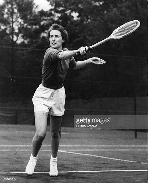 British tennis player Angela Mortimer in action during a women's singles match at the Connaught Championship at Chingford