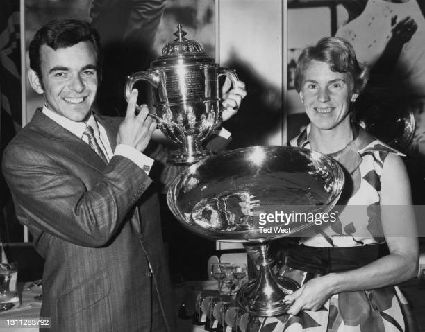 British tennis player Ann Haydon-Jones and golfer Tony Jacklin pose with their respective British Sportswoman and Sportsman of the Year trophys...