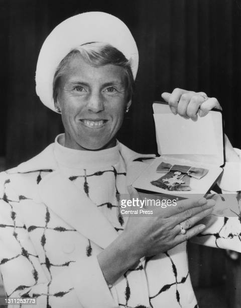 British tennis player Ann Haydon-Jones poses with the Member of the Most Excellent Order of the British Empire Medal for services to lawn tennis...