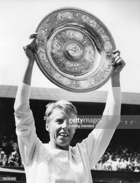 British tennis player Ann Jones holds the Women's Singles trophy at Wimbledon tennis championships after her victory over BillieJean King Original...