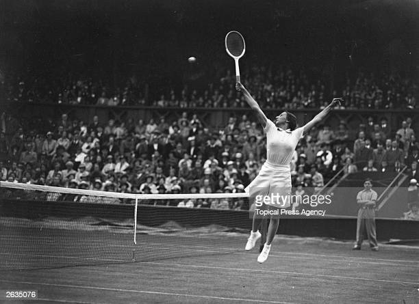 British tennis player Dorothy Round in action at Wimbledeon against the USA's Helen Jacobs during their Wightman Cup tennis match Original...