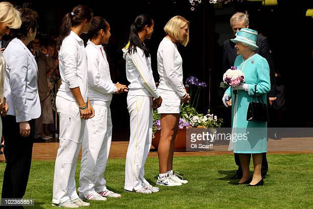 British tennis player Elena Baltacha greets Queen Elizabeth II as she attends the Wimbledon Lawn Tennis Championships on Day 4 at the All England...