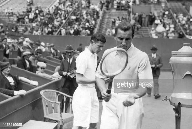 British tennis player Fred Perry checks his racket here in may 1934 at Roland Garros stadium before his match against French Christian Boussus during...