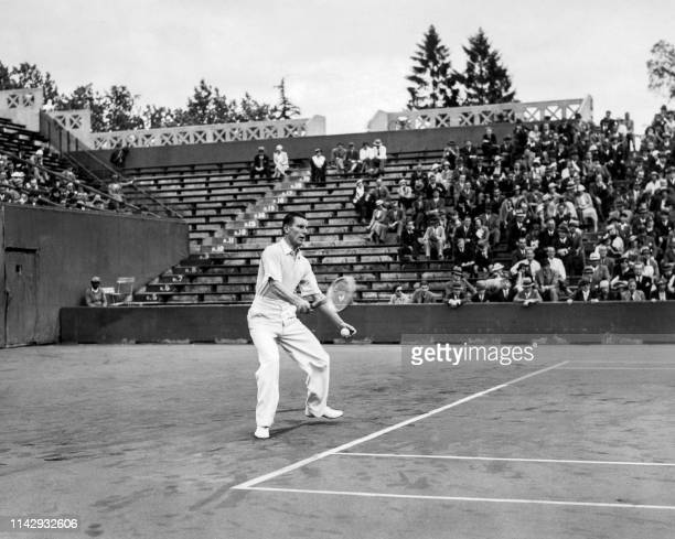 British tennis player Fred Perry is in action here in may 1934 at Roland Garros stadium in his match against French Christian Boussus during the...