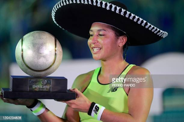 British tennis player Heather Watson poses with the trophy wearing a sombrero after winning the Mexican Tennis Open WTA final match against Canada's...