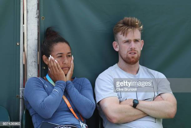 British tennis player Heather Watson reacts as she watches Kyle Edmund of Great Britain as he is defeated in three sets by Frances Tiafoe of the...