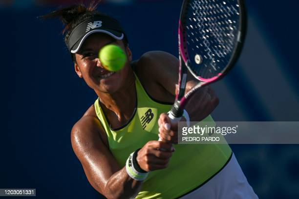 British tennis player Heather Watson returns the ball to US player Coco Vandeweghe during their WTA Mexico Open women's singles tennis match in...