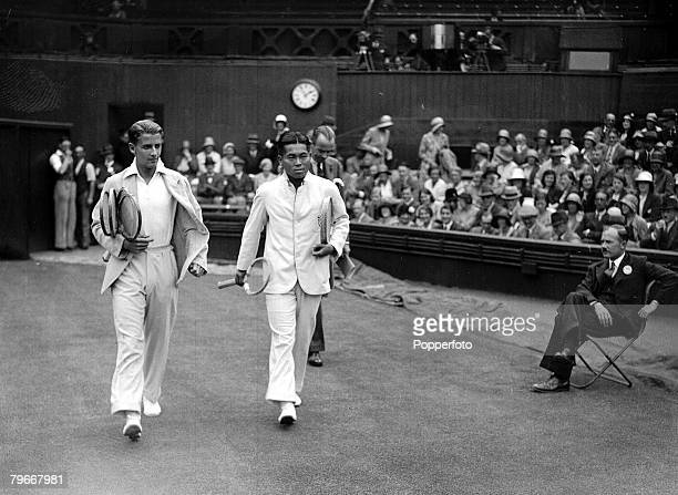"""British tennis player H,W, """"Bunny"""" Austin walks out on to the court with his Japanese opponent, Hyotare Satoh, before the start of their second round..."""