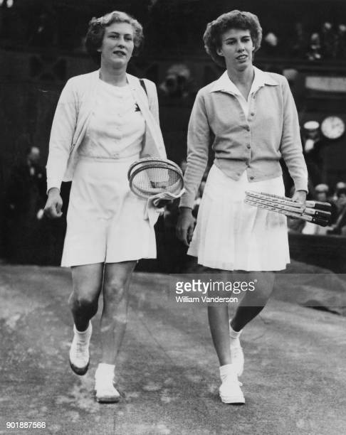 British tennis player Jean Bostock and US player Doris Hart walk onto Centre Court for their match in the Women's Singles of the Wimbledon...