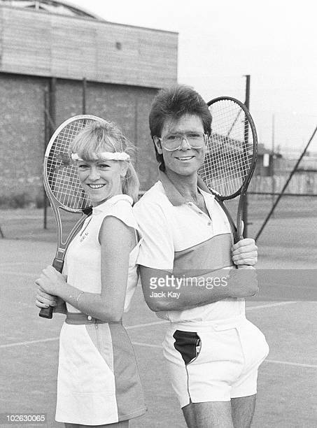 British tennis player Sue Barker poses with singer Cliff Richard on November 25 1983