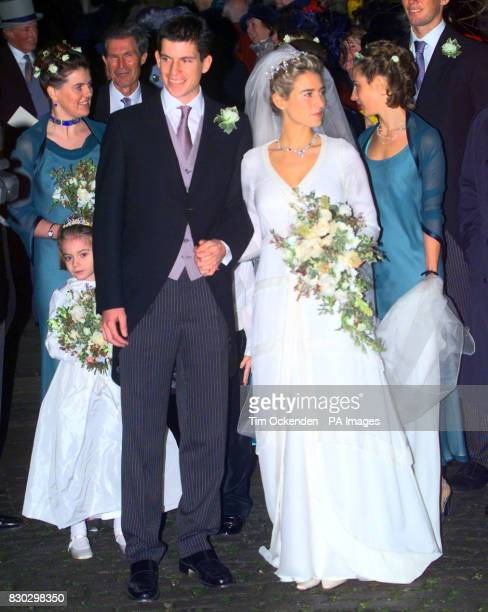 British tennis player Tim Henman with his bride Lucy Heald after their wedding at All Saints Church Odiham in Hampshire
