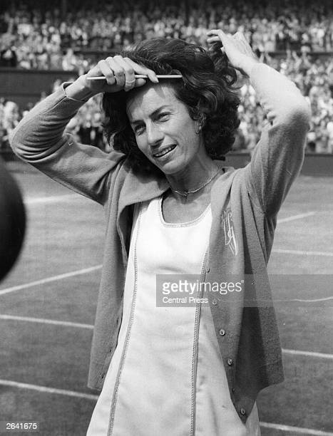 British tennis player Virginia Wade combing her hair as she prepares to meet the Queen after her victory in the Women's Singles Final at Wimbledon...
