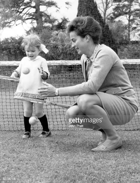 British tennis player Virginia Wade in the garden of her family home at Loddington Kent playing with her small niece Rebecca