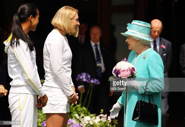 British tennis players Anne Keothavong and Elena Baltacha meet Queen Elizabeth II as she attends the Wimbledon Lawn Tennis Championships on Day 4 at...