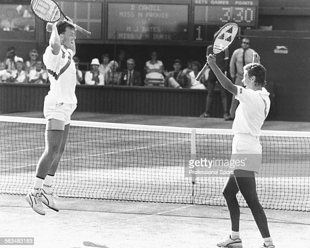 British tennis players Jeremy Bates and Jo Durie celebrate after winning the match point in the mixed doubles final at Wimbledon Tennis Championships...