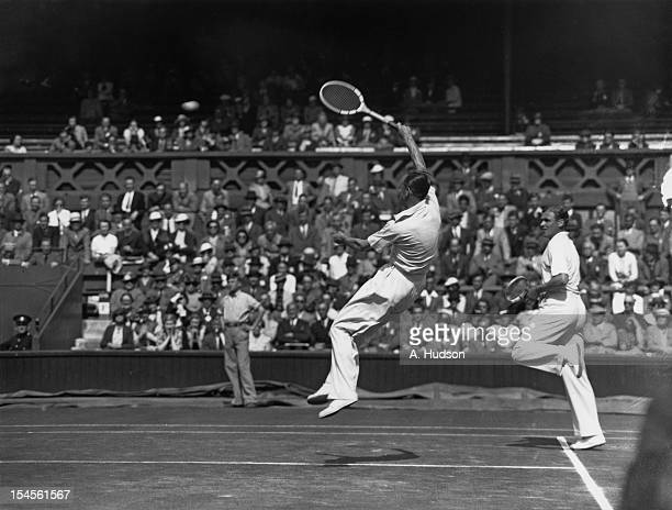British tennis players Raymond Tuckey and Pat Hughes in action during their Davis Cup Challenge Round doubles match against Jack Crawford and Adrian...