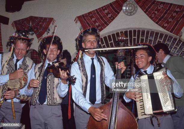 BUCHAREST ROMANIA British tennis players Stuart Bale Jeremy Bates and Andrew Castle playing in a traditional Romanian band at an event during the...