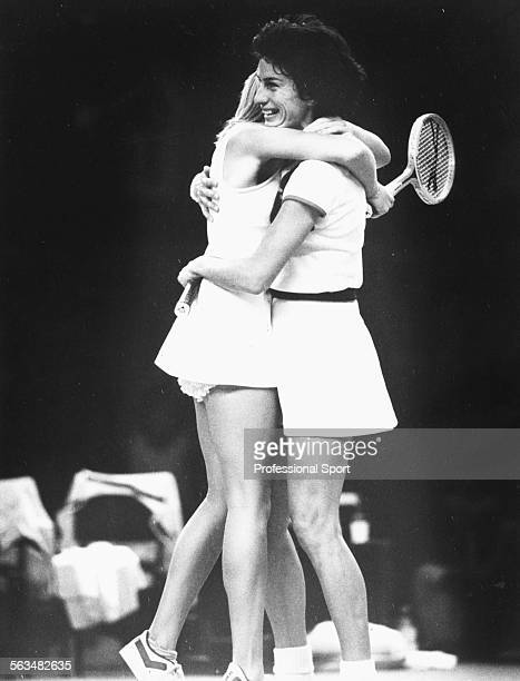 British tennis players Sue Barker and Virginia Wade embrace after winning match point in their decisive doubles match against Chris Evert and Pam...