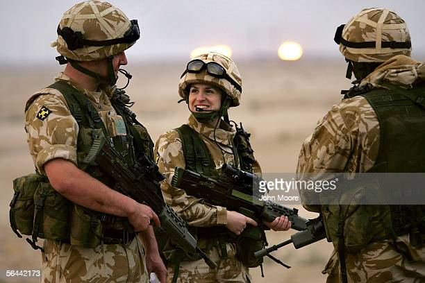 British Territorial Army LCpl. Nicola Baines talks with fellow soldiers while at a checkpoint, a day after national parliamentary elections, December...
