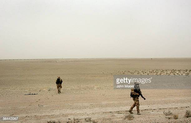 British Territorial Army soldiers patrol through the desert December 16, 2005 on the outskirts of Basra, Iraq. The British government announced...