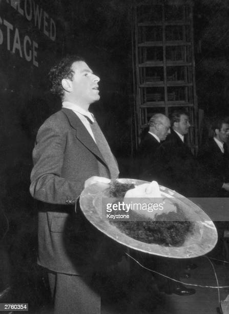 British theatre and film director Sir Peter Brook holding the head of John the Baptist on a plate, presumably for his 1949 production of Strauss'...