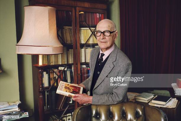 British theologian and Oxford academic John Norman Davidson Kelly at his home with a copy of his latest publication 'The Oxford Dictionary of Popes'...