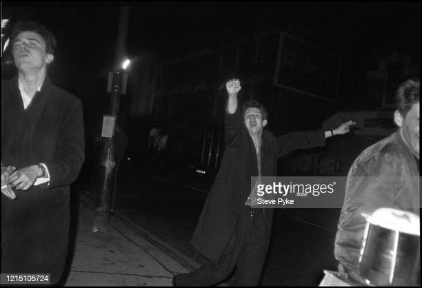 British tin whistle player and singer Spider Stacy and British singersongwriter Shane MacGowan on Cricklewood Broadway in London England 1984 The...
